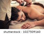 handsome young man relaxing... | Shutterstock . vector #1027509160