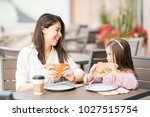 pretty young hispanic mother... | Shutterstock . vector #1027515754