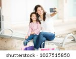 cute young mother and daughter... | Shutterstock . vector #1027515850