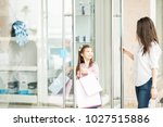 cute little girl holding lots... | Shutterstock . vector #1027515886