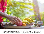 Small photo of Hand of old woman preparing a food, pox, chicken, fruits for pray and make offering. For luck In various events such as New Year, and a new home, ordained, and marriage.