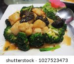 broccoli  big scallop  sauce | Shutterstock . vector #1027523473