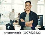 young asian designer smiling... | Shutterstock . vector #1027523623