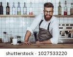 handsome male barista is... | Shutterstock . vector #1027533220
