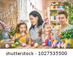 mother  father and daughters... | Shutterstock . vector #1027535500