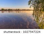 sunrise on the lake. comana... | Shutterstock . vector #1027547224