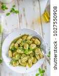 Small photo of Pesto gnocchi, garlic and fresh herbs olive oil, delish homemade, food photography