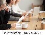 attentive senior businessman... | Shutterstock . vector #1027563223