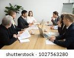 focused black team leader... | Shutterstock . vector #1027563280