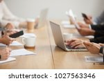 business people sitting... | Shutterstock . vector #1027563346