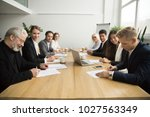 senior and young businessmen... | Shutterstock . vector #1027563349