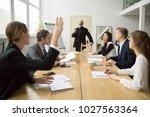 businesswoman raising hand up... | Shutterstock . vector #1027563364