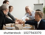happy smiling corporate team of ... | Shutterstock . vector #1027563370