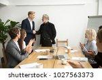senior gray haired businessman... | Shutterstock . vector #1027563373