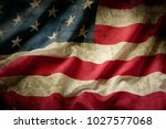 closeup of grunge american flag | Shutterstock . vector #1027577068
