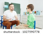 confident school psychologist... | Shutterstock . vector #1027590778