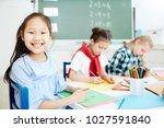 cute schoolgirl with toothy... | Shutterstock . vector #1027591840