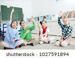 group of elementary schoolkids... | Shutterstock . vector #1027591894