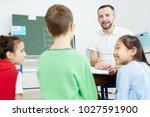 happy school teacher or... | Shutterstock . vector #1027591900