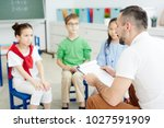 school psychologist reading... | Shutterstock . vector #1027591909