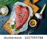 raw beef meat on a wooden... | Shutterstock . vector #1027595788