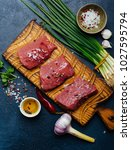 raw beef meat on a wooden... | Shutterstock . vector #1027595794