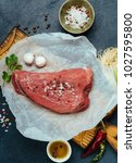 raw beef meat on a wooden... | Shutterstock . vector #1027595800