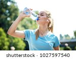 young fitness woman having... | Shutterstock . vector #1027597540