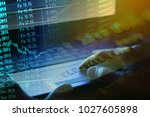 financial data on a monitor.... | Shutterstock . vector #1027605898