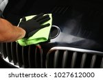 the worker polishes the car... | Shutterstock . vector #1027612000