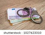 Handcuffs On The Euro Bills....