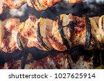 bbq meat prepare on fire  | Shutterstock . vector #1027625914
