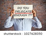 Small photo of Duties or responsibilities delegation concept with employee holding a paper sheet in his hands
