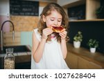 girl sitting on the table in... | Shutterstock . vector #1027628404
