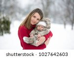 beautiful mother and cute baby... | Shutterstock . vector #1027642603