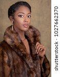 gorgeous woman in fur coat   Shutterstock . vector #1027662370