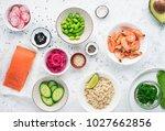Small photo of Fresh ingredients for prawn edamame salmon poke bowl. Top view.