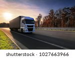 white truck driver on the road... | Shutterstock . vector #1027663966