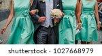 groom walking with bridesmates... | Shutterstock . vector #1027668979