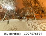Snow Covered Park At Night.