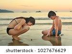 teenager siblings on seaside... | Shutterstock . vector #1027676629