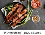 grilled meat. pork skewers on... | Shutterstock . vector #1027681069