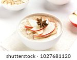 bowl of oats porridge with red... | Shutterstock . vector #1027681120