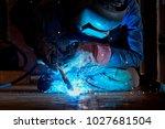 welder working at the factory ... | Shutterstock . vector #1027681504