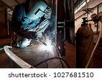 welder working at the factory ... | Shutterstock . vector #1027681510