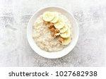 oats porridge with banana...   Shutterstock . vector #1027682938