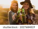 two best friends making a toast ... | Shutterstock . vector #1027684819