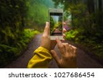 woman taking a photo to the... | Shutterstock . vector #1027686454