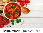 homemade tomato  lentil soup ... | Shutterstock . vector #1027693240