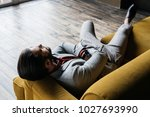lonely handsome man resting on... | Shutterstock . vector #1027693990